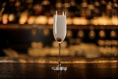 Elegant glass of fresh French 75 cocktail with cherry royalty free stock images