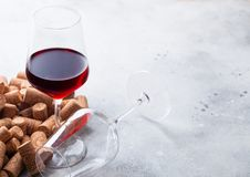 Elegant glass of red wine with corks on stone kitchen table background royalty free stock images