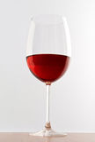 Elegant glass of red wine Stock Images