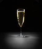 Elegant glass of vine with bubbles on the black ba Royalty Free Stock Images
