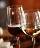 Elegant glasses of red and white wine Stock Image