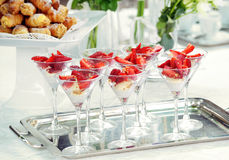 Elegant glasses of strawberry dessert on a buffet Stock Image
