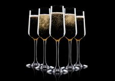 Elegant glasses of yellow champagne with bubbles. On black background with reflection Stock Photography
