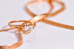 Elegant gold amid gold snake chain weave Stock Photo