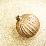 Elegant Gold Christmas background with golden ball. Holiday  Gli Stock Photo