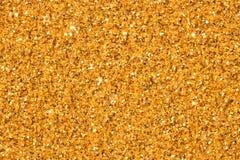Elegant gold glitter sparkle confetti background or party invite for happy birthday, glitzy golden Christmas texture. Elegant gold glitter sparkle confetti stock photo