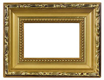 Elegant gold pictureframe macro. Elegant  handmade wooden  mass production golden picture frame, paint from a bronze powder compound- isolated with patch Royalty Free Stock Images