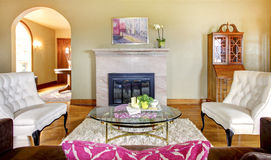 Elegant gold and pink fireplace living room. Royalty Free Stock Image