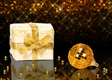 Elegant Golden Christmas. A glamourous golden Christmas illustration: A white gift box with a golden Christmas ball and Stock Photo