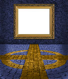 Elegant golden frame on blue painted wall Royalty Free Stock Image