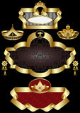 Elegant golden frame with patterns of crowns on a. Black background Stock Photography