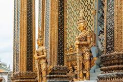 Elegant golden giant guardian statue of Bangkok Grand Palace bui Stock Photo