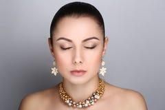 Elegant golden jewelry Royalty Free Stock Images