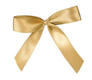 Elegant golden ribbon bow isolated on white Stock Photos