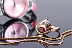 Elegant Golden ring with a ruby and gold chain Royalty Free Stock Photography