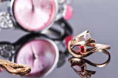 Elegant Golden ring with a ruby and gold chain Stock Photography
