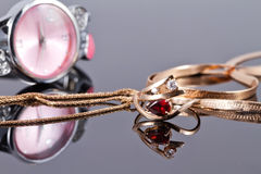 Elegant Golden ring with a ruby and gold chain Royalty Free Stock Photo
