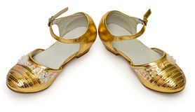 Elegant golden shoes for girl on white Royalty Free Stock Image