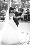 Elegant gorgeous happy bride and groom performing their first da Stock Images