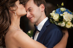 Elegant gorgeous happy  brunette bride and groom standing on the Stock Photography