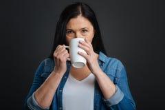 Elegant gorgeous woman enjoying hot drink Royalty Free Stock Images