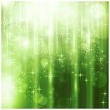 Elegant grön julkort med sparkling lampor Arkivbild