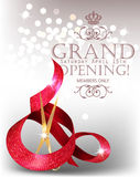 Elegant grand opening card with textured curled red ribbon and scissors. Royalty Free Stock Photo