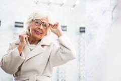 Elegant grandma having her glasses fitted Stock Images