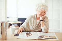 Elegant Grandmother Reading at Home Royalty Free Stock Photo