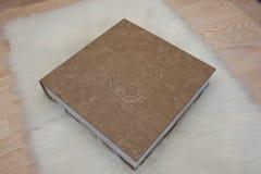 Elegant gray brown and white leather wedding book or album. Stock Photos