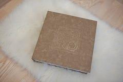 Elegant gray brown and white leather wedding book or album. Royalty Free Stock Photos