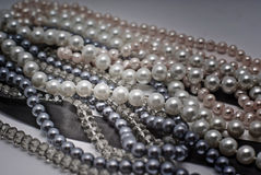 Elegant gray pearls. In the dark with spot of light royalty free stock photos