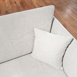 Elegant gray sofa with cushion. On wooden floor royalty free stock images
