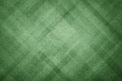 Green abstract background with modern geometric pattern design and old faded vintage texture in dark Christmas color. Elegant green abstract background with Royalty Free Stock Images