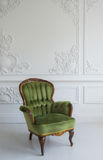 Elegant green armchair in luxury clean bright white interior royalty free stock photo