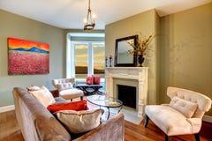 Elegant green living room green walls. Royalty Free Stock Photos