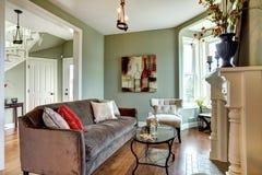 Elegant green living room green walls. Stock Photos