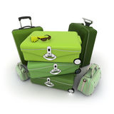 Elegant green luggage kit. Luggage kit in green shades with traveller�s sunglasses and gloves on top Stock Photos