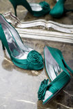 Elegant Green Shoes. Pair of Green Elegant lady's shoes on a marble table with a mirror reflection Royalty Free Stock Photos