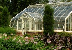 Elegant Greenhouse. Greenhouse in a city park Royalty Free Stock Photo