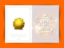Elegant greeting card for St. Patricks Day celebration. Elegant greeting card with text Luck of Irish and glossy golden pot full of coins for Happy St. Patricks Stock Photography