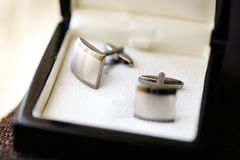 Elegant groom`s cuff links in a box Royalty Free Stock Image