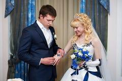 Elegant groom wears wedding ring happy bride stock images