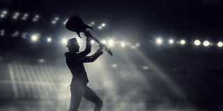 Elegant guitarist silhouette . Mixed media Royalty Free Stock Photo