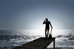 Elegant guitarist silhouette Stock Photo
