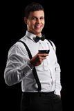 Elegant guy holding a glass of red wine Stock Photography