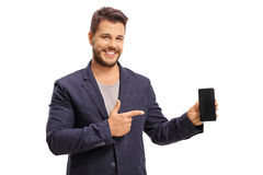 Elegant guy holding a phone and pointing Stock Photos