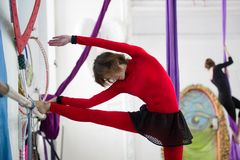 Elegant gymnast doing stretching with barre in a studio. Elegant beautiful gymnast doing stretching twine exercise with barre in a studio Royalty Free Stock Photos