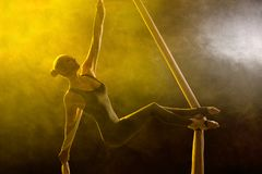 Graceful gymnast performing aerial exercise Royalty Free Stock Photo