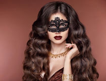 Elegant hairstyle. Beautiful brunette girl model. Fashion golden Royalty Free Stock Photography